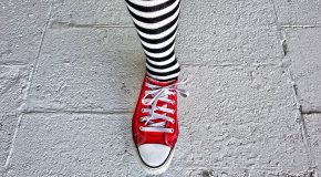 leg with striped sock and red shoe