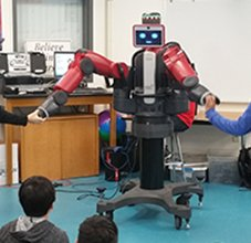 students interacting with a large robot